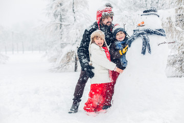 Dad with children playing in snow