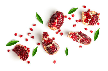 pomegranate slices and green leaves isolated on a white background, top view