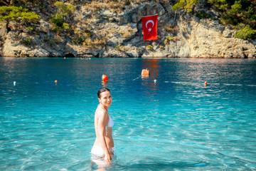 Young attractive girl in Blue Lagoon in Oludeniz, Turkey