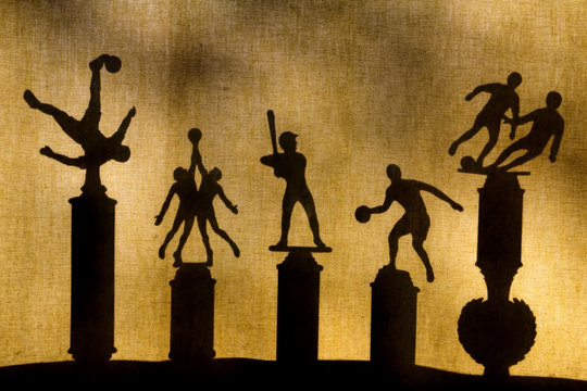 Sports Trophies Silhouettes through Curtains