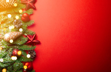Christmas tree decorations with ornaments on red background. Christmas background with copy space.