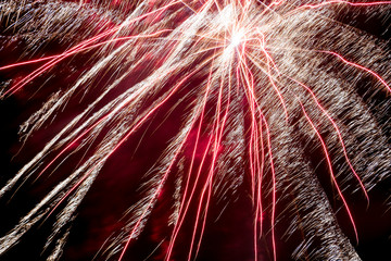 silvester background with exploding rocket with white stripes and red illuminated background
