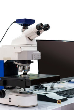 modern & high accuracy microscope during sample or specimen inspection for quality control in industrial metallurgy electronic science etc isolated with clipping path