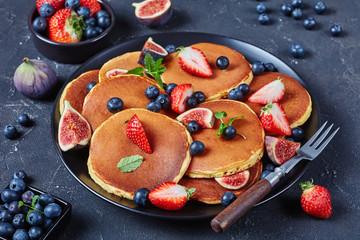 almond pancakes on a black plate, close-up