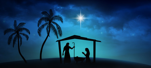 Christmas time. Manger with baby Jesus, Mary, Joseph and star of Bethlehem. Copy space.