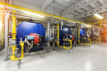 Modern industrial gas boiler room equiped for heating process. Heating gas boilers, pipelines, valves.