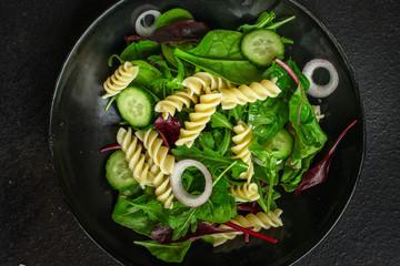 pasta salad Fusilli (leaves Lettuce, Spinach, Vegetables, Gemelli) Menu Concept. food background. copy space. Top view