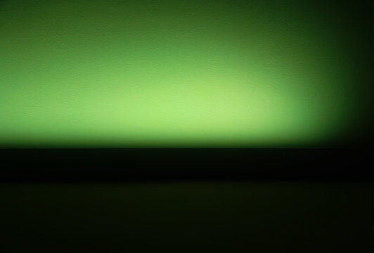 Green empty wall at night club abstract background