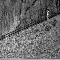Girl on old stone stairs