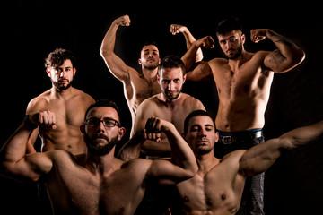 Group ofShirtlessSporty Muscular Man posing on Dark Background