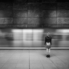 Girl in front of a fast moving train