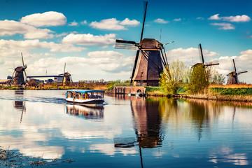 Walking boat on the famoust Kinderdijk canal with windmills. Old Dutch village Kinderdijk, UNESCO world heritage site. Netherlands, Europe. Fotomurales