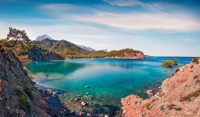 Marvelous Mediterranean seascape in Turkey. Sunny view of a small azure bay near the Tekirova village vith Mt. Tahtali on background. Beauty of nature concept background.
