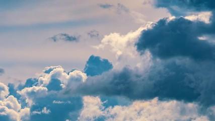 Fotobehang - Epic storm clouds rolling over blue sky background. 4K UHD Timelapse.