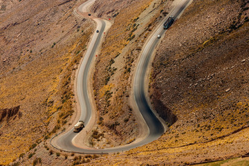 Winding road with trucks between mountains in Jujuy, Argentina