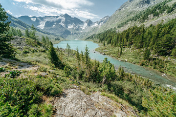 Wall Mural - Wild russian nature. Beautiful landscape with emerald lake in the mountains. Lake with clear turquoise water. Traveling in the Altai Republic. Katun Nature Reserve.
