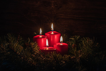 Four Advent burning candles, christmas decoration, postcard concept