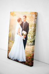Wedding photo printed on canvas on white background. Sample of stretched wedding photography with gallery wrapping