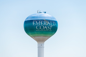 Fort Walton Beach, USA - April 24, 2018: Round water tower with northwest Florida's Panhandle Emerald Coast sign in Gulf of Mexico