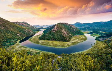 Poster Mediterraans Europa Incredible evening view of Canyon of Rijeka Crnojevica river, Skadar lake location. Fantastic summer sunset of Montenegro countryside. Beautiful world of Mediterranean countries.