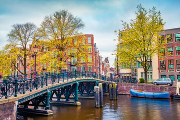 Fotobehang Amsterdam Captivating autumn scene of Amsterdam city. Famous Dutch channels and great cityscape. Gloomy morning landscape in Netherlands, Europe. Traveling concept background.