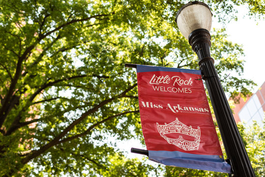 Little Rock, USA - June 4, 2019: Street sign on lamp post in summer of Miss Arkansas Pageant scholarship advertisement for beauty competition