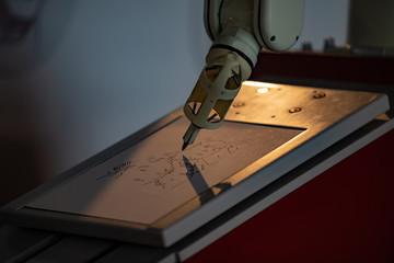 The robot paints a picture. Future concept