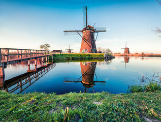 Famous windmills in Kinderdijk museum in Holland, UNESCO World Heritage Site. Picturesque summer scene of Holland countryside, Netherlands, Europe. Traveling concept background.