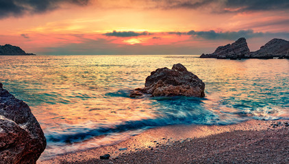 Unbelievable summer view of Petani Beach. Fantastic sunset scene of Cephalonia Island, Greece, Europe. Picturesque seascape of Mediterranen Sea. Beauty of nature concept background..