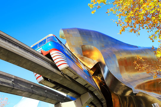 SEATTLE, WASHINGTON - October 25, 2016: The Monorail train passing through the ultra-modern EMP Museum on sunny fall morning