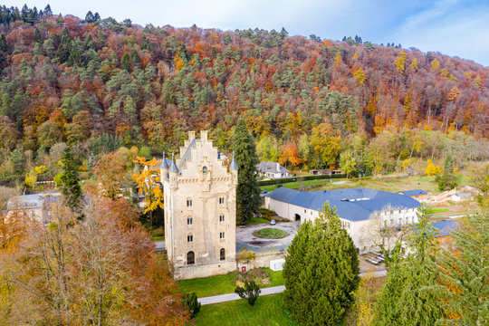 Tower of Schoenfels Castle, Mersch, Kopstal, Mamer or Valley of the Seven Castles in central Luxembourg. Fall in Luxembourg, hills covered with forest, spectacular red, gold and yellow autumn leaves