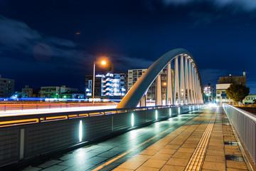 A bridge crossing the Sai sea on the Ishikawa street at night in Kanazawa, Japan.