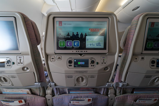 BERLIN - APRIL 26, 2018: Passenger seats of an economy class of the world's largest aircraft Airbus A380. Emirates Airline.