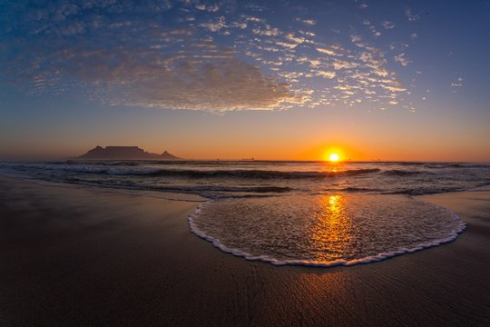 Sunset over the shore of the famous Table mountain in Cape Town, South Africa