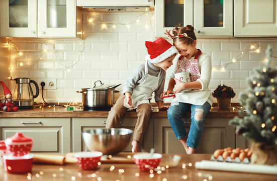 happy children boy and girl bake christmas cookies