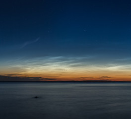 mesospheric clouds, silvery over the sea