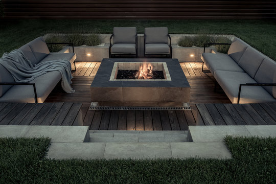 Outdoor zone for relax with burning fire pit
