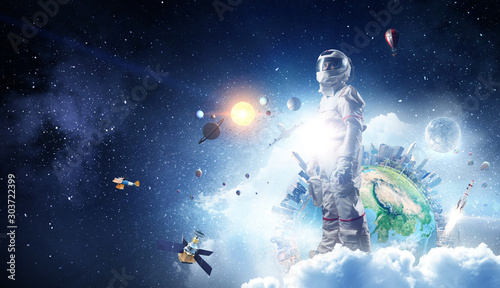 Fototapete Spaceman and his mission. Mixed media