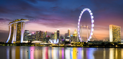 Stunning view of the Marina Bay skyline with beautiful illuminated skyscrapers during a breathtaking sunset in Singapore. Singapore is an island city-state off southern Malaysia.