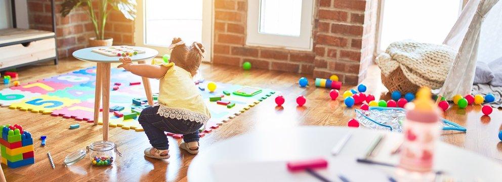 Beautiful toddler playing at kindergarten