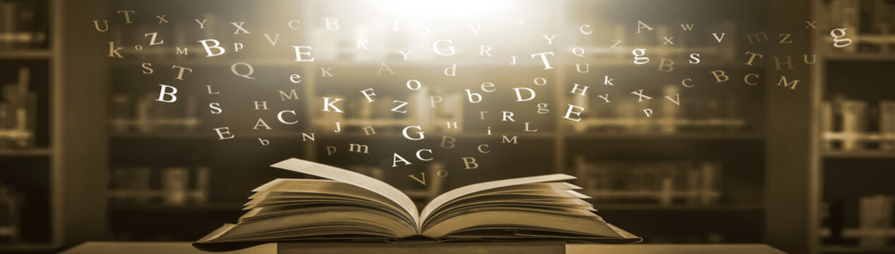 Imagine opening an old book blurred with magic power on the table and the English alphabet floating above the book with magic light as a beautiful background design.
