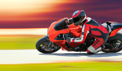 Motorcycle leaning into a fast corner on race track Fototapete