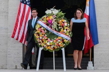 U.S. Secretary of Defense Mark Esper and his wife Leah Esper lay a wreath at the Manila American Cemetery and Memorial
