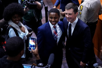 U.S. Democratic presidential candidate Pete Buttigieg shakes hands and takes photos with attendees following his visit to Morehouse College in Atlanta