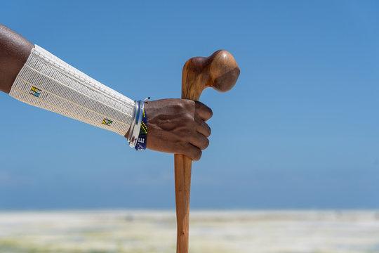 Tribal masai hand with a colorfull bracelet, closeup. Zanzibar, Tanzania, Africa