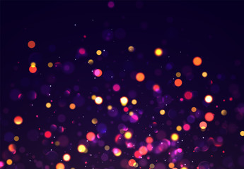 Bokeh sparkle glitter lights background. Defocused circular . Magic christmas gold and purple, blue and orange background.