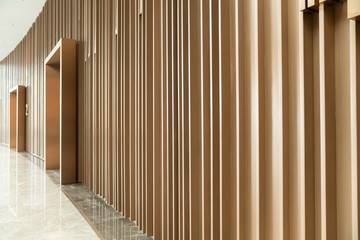 Detail of Random wooden strip wall in vertical direction at pre-function space / interior / natural...