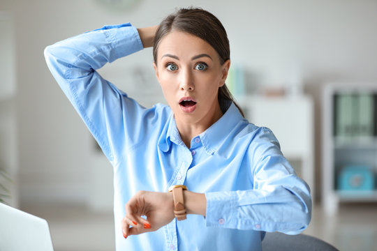 Stressed young woman trying to meet deadline in office