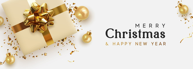 Fototapete - Holiday banner Merry Christmas and Happy New Year. Xmas design with realistic objects, beige gift box, golden balls, stast tinsel, glitter gold confetti. Festive horizontal poster, flat top view