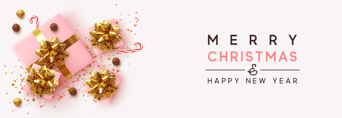 Fototapete - Banner Merry Christmas and Happy New Year. Realistic pink gift boxes, glitter gold confetti, Chocolate round candy in foil, sweet cane. Xmas present. flat lay, top view. Vector illustration